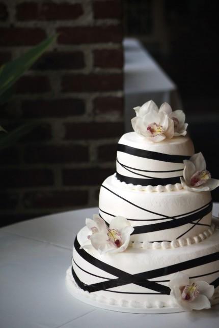 black ribbon wedding cake with flowers